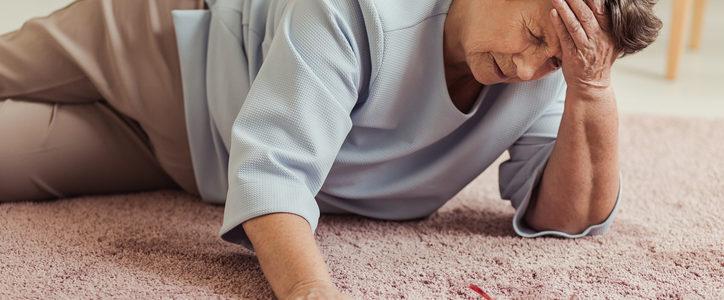 senior woman on floor