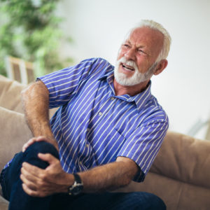 senior man with knee pain