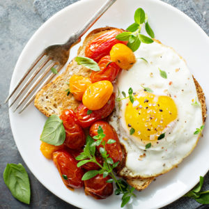 toast with fried egg and tomatoes