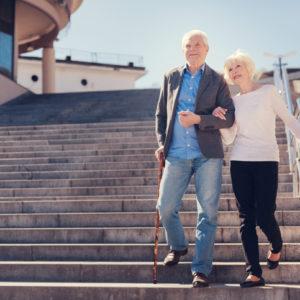 senior couple walking down stairs